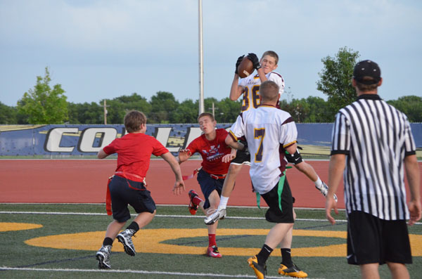 Hillsboro?s Carson Herbel catches a touchdown pass while defended by Stuchlik. Free Press Photo by Janae Rempel