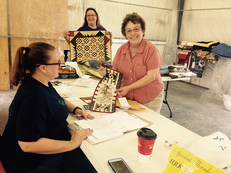 The volunteer crew charged with determining the winning entries in the Open Class Quilting Division at last week?s Marion County Fair include (from left) Shauna Lacio, Hillsboro, superintendent; Colleen Westerman, Galva, judge; and Flo Rahn, Hillsboro, superintendent. Aleen Ratlzaff/Free Press