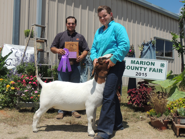 Lisa Geis showed the grand champion market goat. Courtesy photo by Rickey Roberts