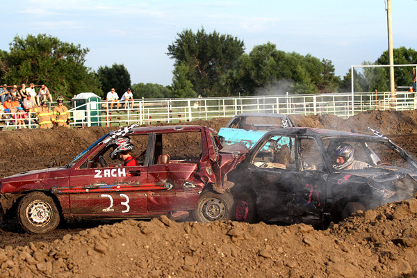 Zach Anderson in car No. 23 attempts to push David Smith up onto the berm to eliminate him from the event. Smith worked himself free, but Zach won the compact car event at the annual Marion County Demolition Derby during the Marion County Fair on Saturday, July 25. Phyllis Richert photo