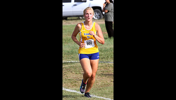 Freshman Julie Loewen shows the form that led to a 34th-place finish in 16:44.3 at the JK?Gold Classic. She was the sixth KCAC athlete to finish. Phyllis Richert Photo<p>Freshman Julie Loewen shows the form that led to a 34th-place finish in 16:44.3 at the JK?Gold Classic. She was the sixth KCAC athlete to finish.