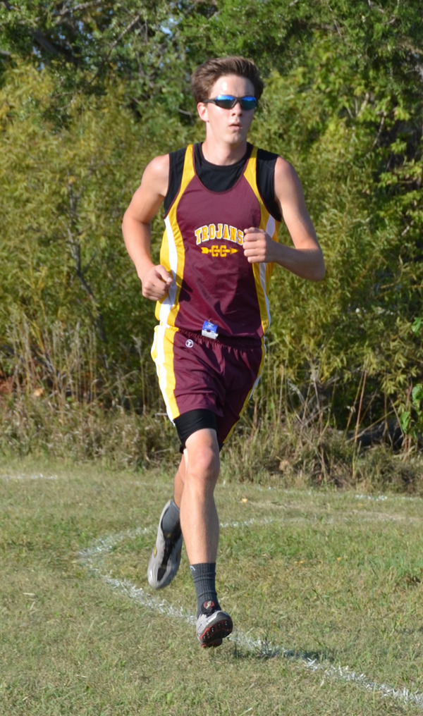 <p>Jonathan Hinerman shows the form that led to a seventh-place finish at the Berean Invitational Thursday with a time of 18:16 in the boys? varsity race (Taylor Plett / HHS Yearbook)
