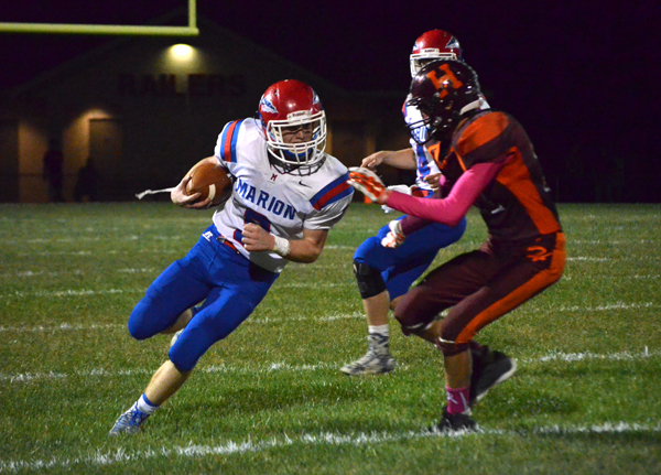 Corbin Wheeler carries the ball for a 7-yard gain during the second quarter at Herington.
