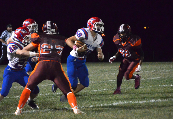 Tyler Palic intercepts a Herington pass in the second quarter.