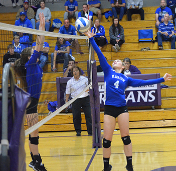 Janae Rempel / Free Press<p>Kirsten Hansen sends the ball over the net against Halstead. Marion lost a 2-1 sub-state quarterfinal battle against the Dragons Saturday, closing the chapter on the most successful volleyball season in Marion school history. The Warriors went 33-4.