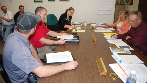 County fire chiefs present their concern for a clearer burn-ban resolution to commissioners Dianne Novak and Randy Dallke (right side of the table) at the Feb. 21 meeting.