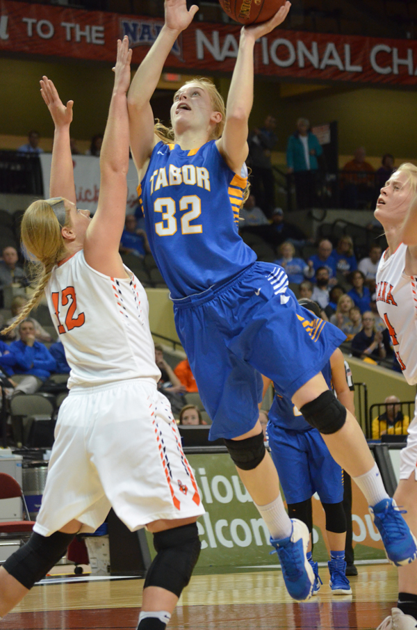 Tena Loewen shoots over an Indiana Tech defender during Tabor's first-round game Wednesday. Loewen scored nine points in Tabor's 67-58 victory. In two games at the national tournament, Loewen contributed 20 points. She concludes her Tabor career with 898 points and 697 rebounds.