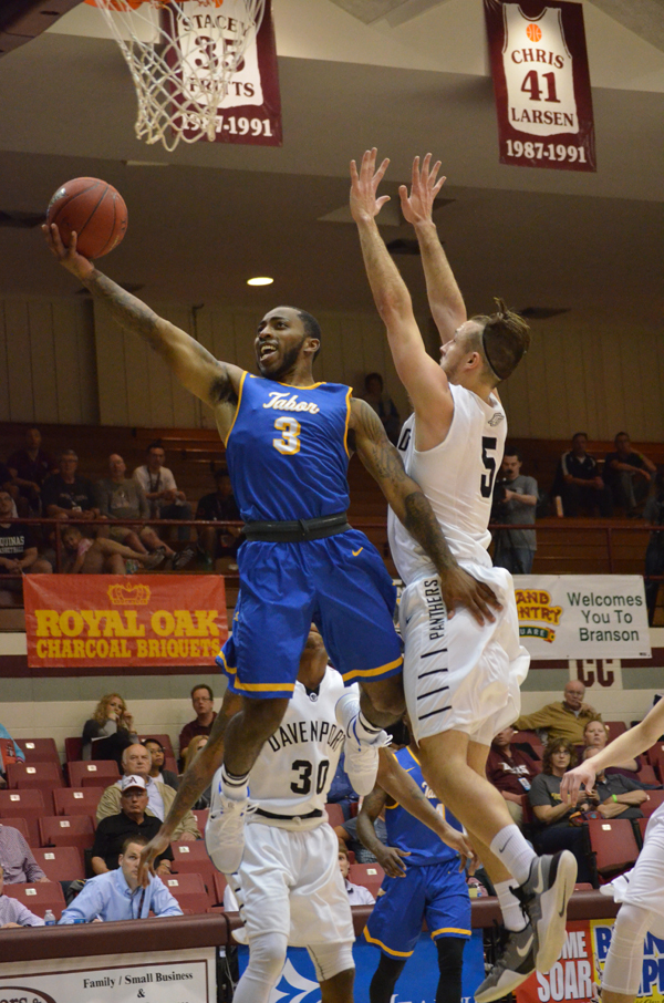 DeShun Patterson shoots for two during Tabor's opening-round game with Davenport Thursday. He scored four points in Tabor's 78-70 win, and, the next day, contributed 21 points to an 88-82 Bluejay victory over Robert Morris.