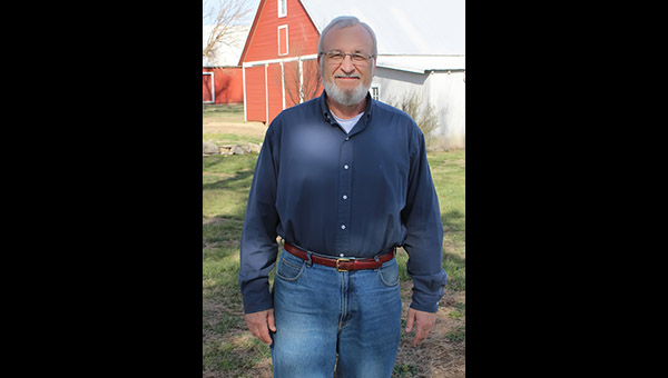 Kent Becker enjoys some remaining free time on the family farm west of Durham before he officially begins his new job as the District 1 commissioner for Marion County March 27. He is the third generation to live at the family location. Becker said his grandfather built the barn in the background around 1917.