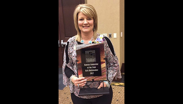 "Kris Burkholder holds the plaque she received March 3 for being the Kansas Counseling Association's ""Kansas Counselor of the Year"" for 2017. ""I can't imagine myself doing anything else,"" said Burkholder, who serves Marion elementary and middle schools. ""I love what I do."""