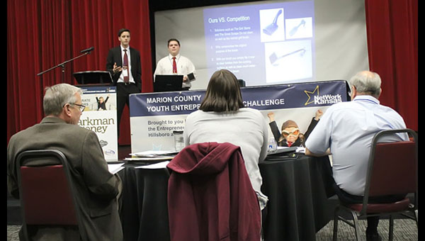 Jonathan Hinerman (left) and Nathan Simhiser make their case for Arrow Grilling in the final round of the second annual Marion County Youth Entrepreneurial Challenge March 7 in the Marion Community Center. The judges, Chris Costello, Ciara Thyfault and Phil Weisenbach (from left), asked questions and evaluated the presentations from each of the three finalist business before declaring Arrow Grilling the winning team.