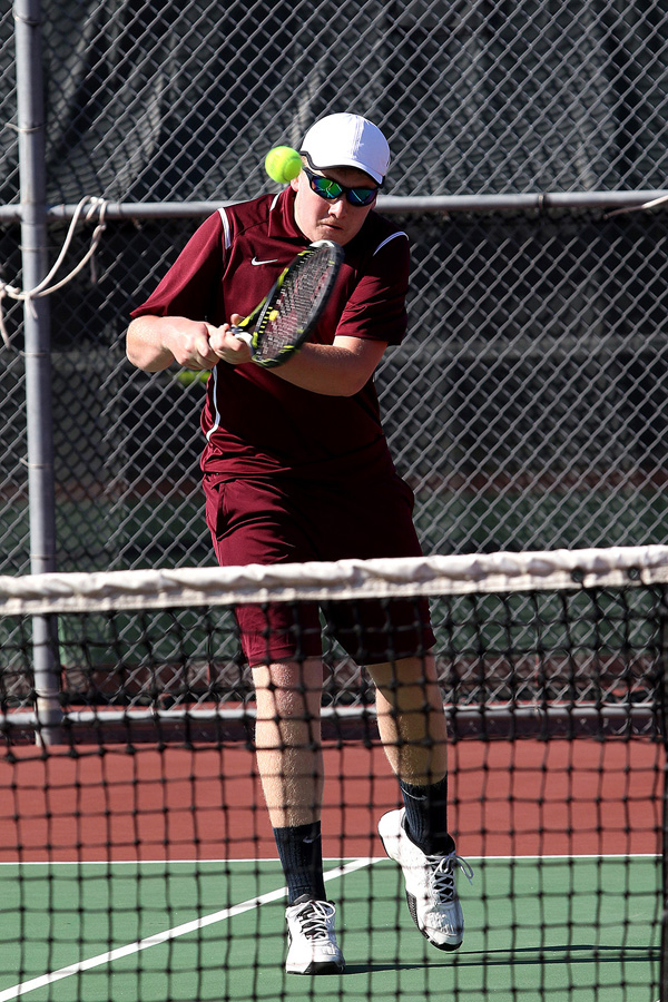 Jacob Isaac returns a volley during No. 1 doubles play Tuesday at Hillsboro's home tournament. Isaac and Dakota Klein scored all 15 of Hillsboro's team points and finished third.