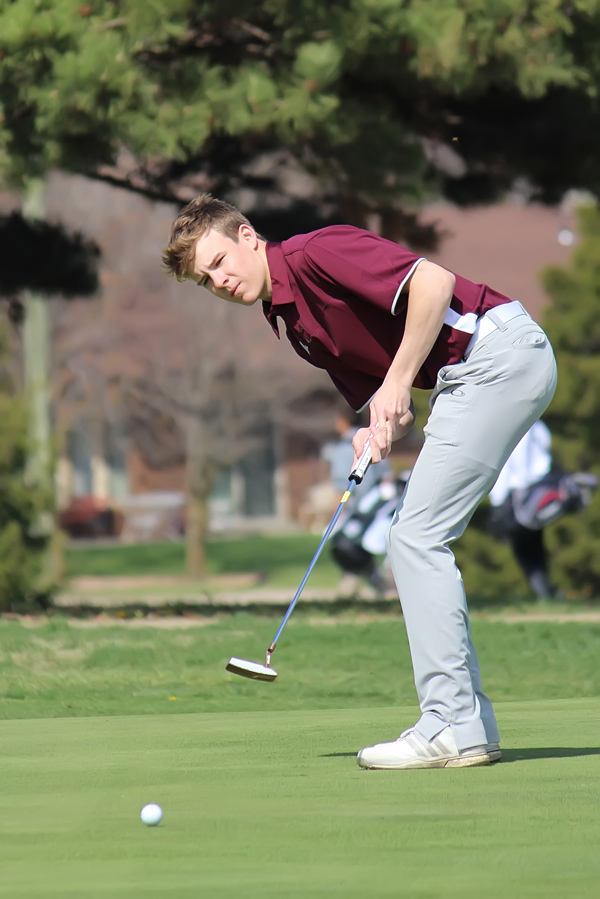 Elliot Ollenburger watches as his putt rolls toward the No. 4 hole during Friday's Hillsboro Invita­tional. Ollenburger nailed the putt on the way to a score of 90 over 18 holes, which placed him third in the field of 51.
