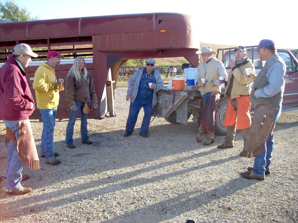 The Just cattle-drive team enjoys some refreshment upon completing the move to Flint Hills pasture grass.