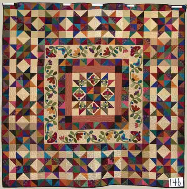This quilt, made by Rose Wiebe Haury of Newton, Charlene Driggers of Hillsboro and Carol Ingenthron of Grantville, sold at auction for this year's relief sale for $15,000.