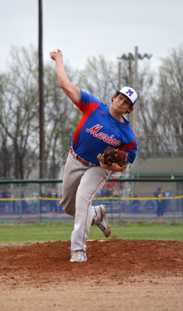 Nathan Baldwin fires a pitch during Game 1 at Council Grove Tuesday. Baldwin threw five shutout innings without surrendering a hit to earn the pitching win. He walked five batters and struck out six Braves.