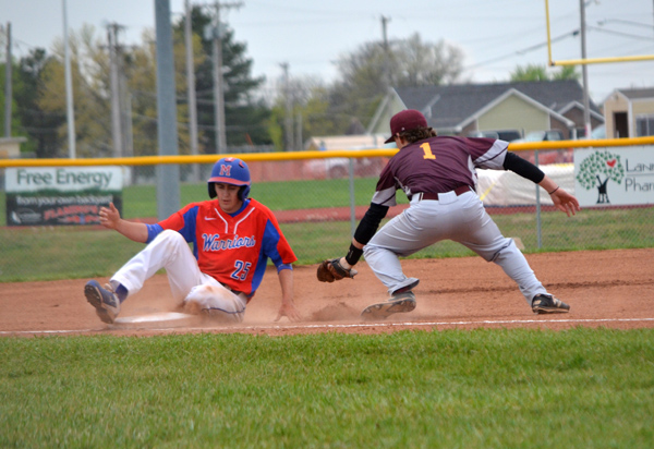 Seth Savage slides safely to third base, avoiding the tag of Hillsboro's Jorge Hanschu during the fourth inning of Game 1 Thursday. Marion won the game, 6-5, and went on to win Game 2, 13-3.