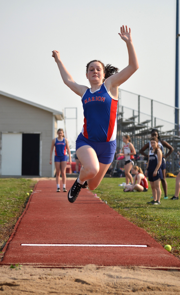 Emmy Hess leaps to a third-place finish in the long jump Tuesday with a distance of 14 feet, 8 inches. Hess was the Marion girls' highest finisher for the day, winning the 100 hurdles in 18.16 seconds.