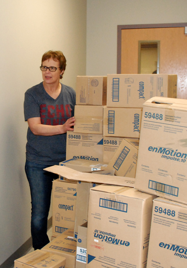 "Marion Regier, Hillsboro Community Hospital CEO, is almost ""boxed in"" as she helps with the move to the new facility along U.S. Highway 56. ""I know sometimes we thought this day was never going to come, but they kept encouraging us."""