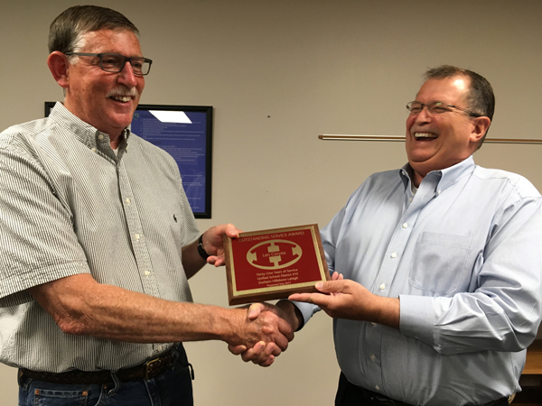 USD 410 Superintendent Max Heinrichs presents USD 410 plaques to Len Coryea