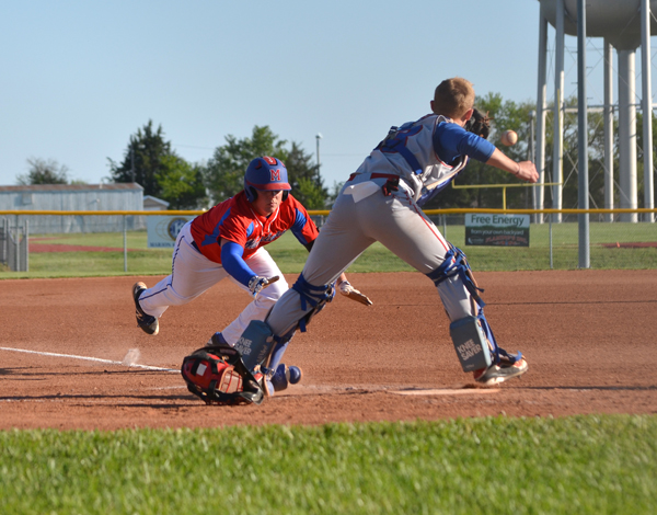 Peyton Heidebrecht slides home before the ball reaches Canton-Galva catcher Jonah Sargent's glove to score via error after hitting a first-inning triple during Game 2 Friday.