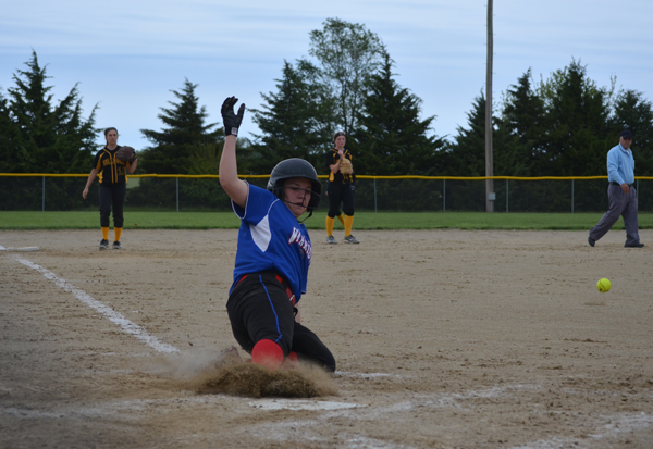 Taelyn Pagel scores to extend Marion's lead over Bennington to 15-4 during the third inning of Game 2 Tuesday. The Warriors swept the Bulldogs, 12-0 and 21-4, and went on to earn two run-rule victories over Canton-Galva later in the week.