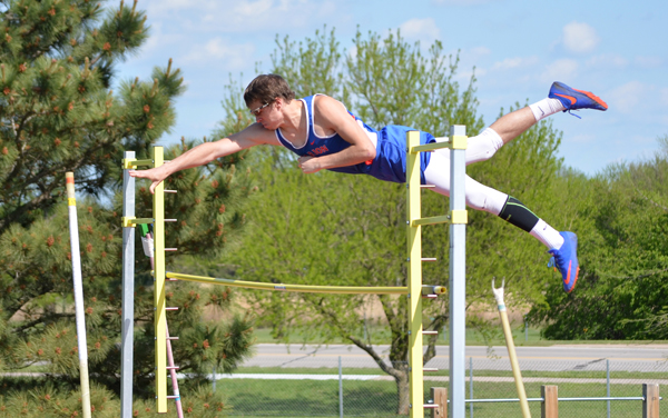 Bryce Shults shows the form that led to a personal-best performance in the pole vault at Hesston Thursday. Shults cleared 13 feet, 6 inches to win the event.