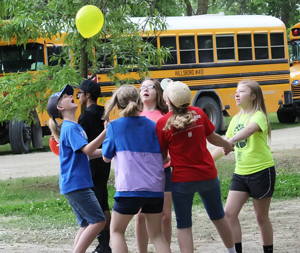A team of girls competes with a team of boys in a game where participants hold hands and attempt to keep the balloon in the air longer than the other team. Pictured are (from left) Airen Fay, Sonora Filipiak, Sammy Phillips, Alana Suderman and Delaney Lucero.