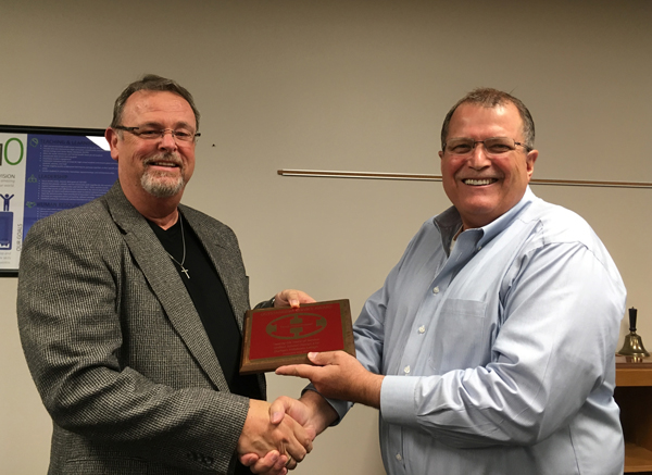 USD 410 Superintendent Max Heinrichs presents USD 410 plaques to Terry Bebermeyer for 26 years.