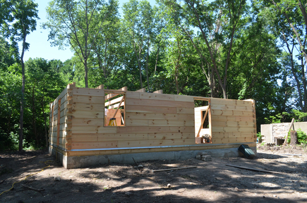 The Appalachian style logs feature dovetail joints at the corners. The cabin will include a main floor and a loft with a cathedral ceiling. A 6-foot-wide porch will wrap around the structure.<p>
