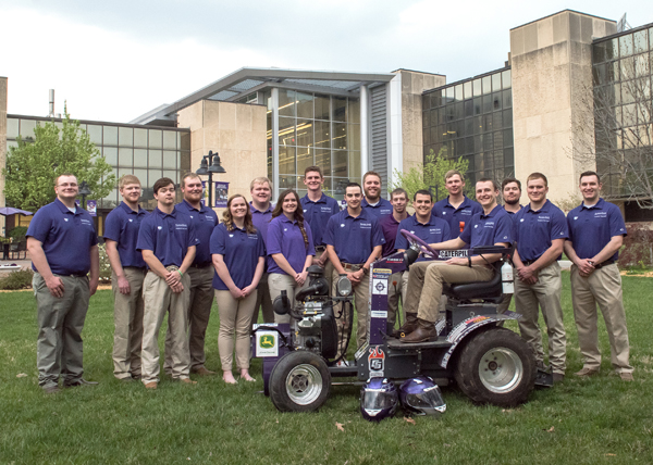 These are the Helwig Farms Quarter-Scale Tractor team members who competed for Kansas State teams at the 20th annual American Society of Agricultural and Biological Engineers' International Quarter-Scale Tractor Student Design Competition. Nicholas Meyer is the sixth person from the left and Jesse Meier is the second member from the right.
