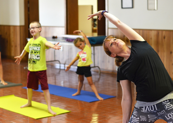 Lesli Beery (right) leads her first kids' yoga class in Hillsboro Monday at City Hall, guiding participants Harrison Beery (left) and Ansley Wichert (middle) into a warrior pose. <p>The half-hour classes, for children ages 3 and older, will be held at 10 a.m. every Monday through July 31. Classes cost $2 per session. Beery also offers kids' yoga classes in Marion Wednesdays at 10 a.m., as well as yoga classes for adults in both communities.