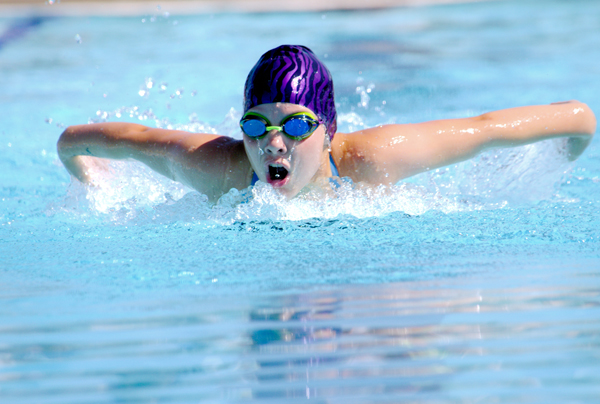 Lauryn Vogt swims the 9-10 butterfly at Hillsboro's home meet July 1, showing the form that propelled her to a first-place finish in that event at Lindsborg Saturday with a time of 16.37 seconds, nearly 4 seconds ahead of second place. Hillsboro will host the eight-team Mid-Kansas League Championship meet Saturday and will look to secure its fourth-consecutive league title.