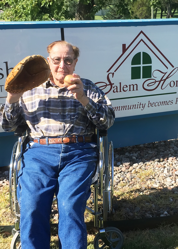 Edmund Steiner, a resident of Salem Home in Hillsboro,  prepares for his big first pitch at the NBS tournament.