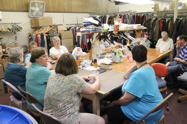 The team of volunteers at the Et Cetera Shop in Hillsboro enjoy a coffee break from sorting and pricing used clothing. Last year the shop generated more than $55,000 for the work of Mennonite Central and donated about $6,000 to local ministries and programs. The volunteers agree that comradery keeps them coming back year after year.