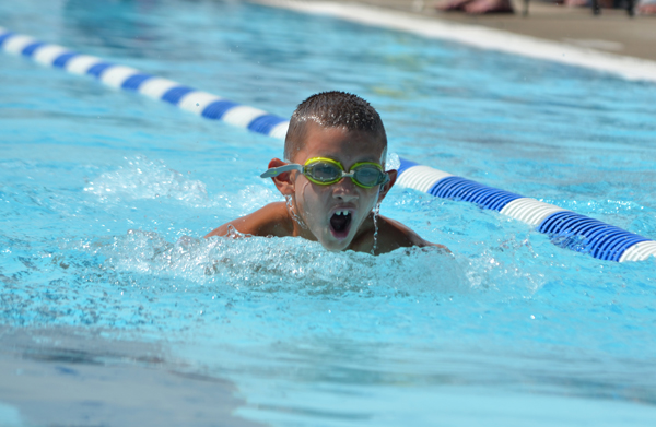 Hillsboro's Jake Sibayan swims the third leg of the boys' 8 and under 100-meter medley relay Saturday at the MKL championship meet. He, with Hudson Rogers, Hudson Schmidt and Colt Bechtold, finished fourth in 2:10.69. Hillsboro won the nine-team meet with 1,077 points.