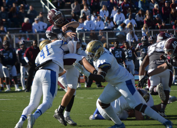 Evan Sprayberry and DiMitri Bowie pressure Bethel's quarterback during Tabor's Nov. 12 game last season. A first team, All-America selection and unanimous All-KCAC first-team pick, Sprayberry was the KCAC's sack leader a year ago. He, along with Bowie, a KCAC honorable mention selection, return to anchor Tabor's defensive line this season.