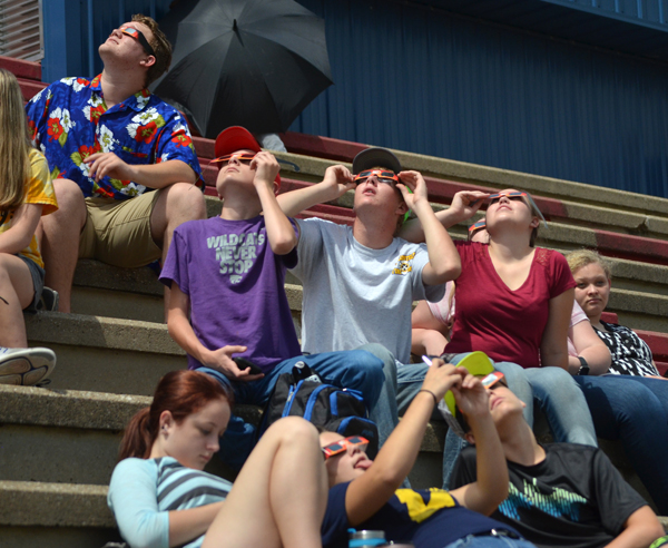 Marion High School students and staff took a break from classes to view Monday's solar eclipse at Warrior Stadium (below).