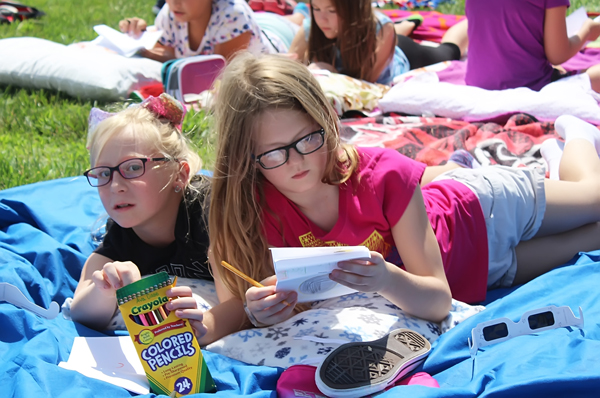 During the break, Ava Case and Cassidy Bernhardt (lower left) and the rest of the group were asked to draw a picture of what they had seen. The fifth-graders repeated the routine as the eclipse passed.<p>