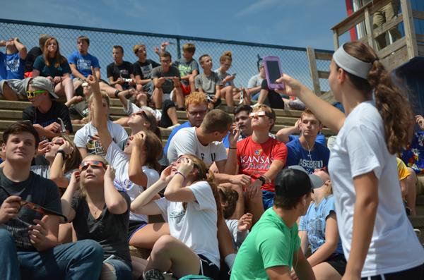 Marion: Alli Molleker (above) documents classmates viewing Monday's solar eclipse.