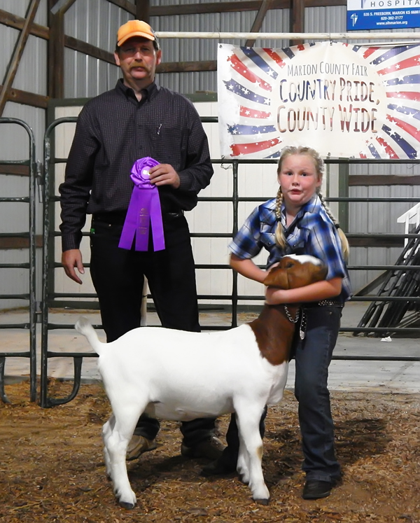 MARKET GOATS: Charlie Peters (top photo) of the South Cottonwood club showed the grand champion market goat at this year's fair. Ryleigh Jones (lower photo) showed the grand champion breeding goat.