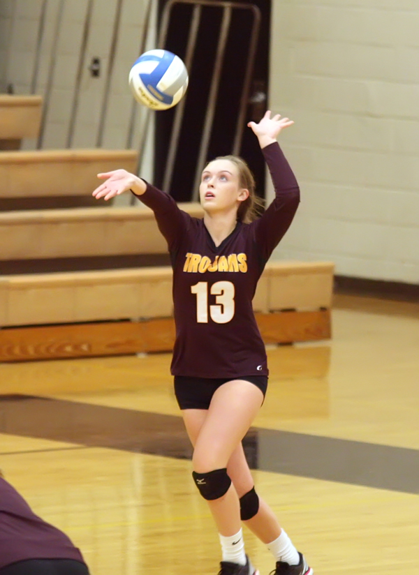 Trojan senior Taylor Helmer delivers a serve against Halstead during their opening match at the Central Kansas League Pre-season Tournament in Haven. Hillsboro posted a 2-4 record for the day to place seventh.