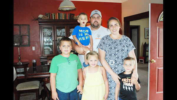 "Parents Kelley and Kristi Jantz of Burns with their four children: Eli, held by his father, in front are Connor, Addison and Dominic with his mother. ""We are thankful for each day he is blessed with health in spite of his failing liver,"" Kristi said. ""But we have been advised, and strongly feel like now is the time ask for help."""