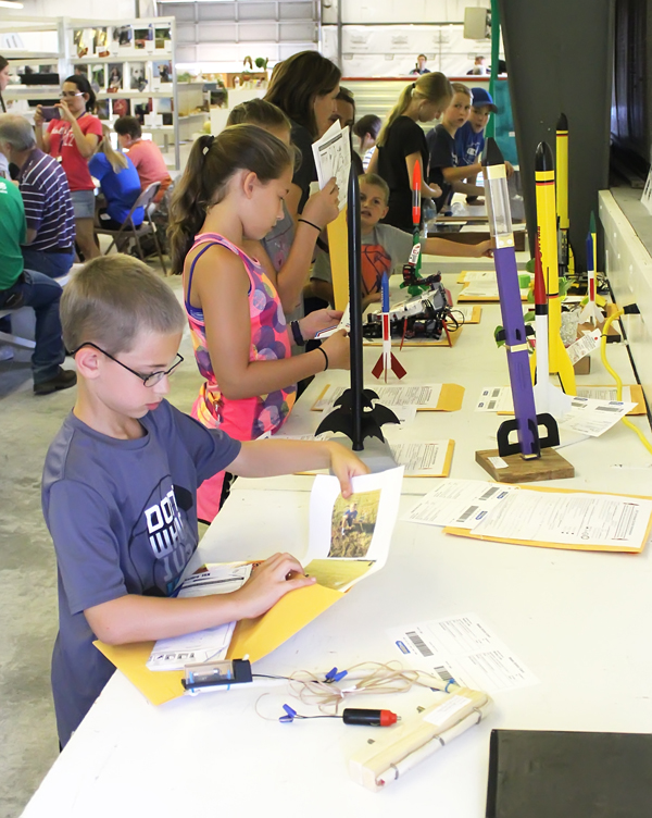 >4-H ROCKETRY: Contestants collect their packets of information regarding their projects. In the 4-H Division, Alyssa Boden of the Goessel Goal Getters was the champion of the Age 9-13 class and Micah Carlson of the Lincolnville Wide Awake club was the Age 7-8 champion.