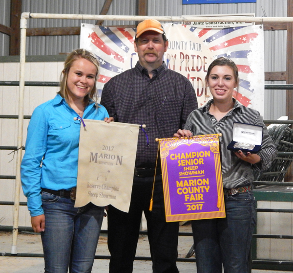 The top two places in sheep showmanship went to reserve champion SaRae Roberts (left) of the South Cottonwood club and champion Corin Parmley of the Happy Hustlers.