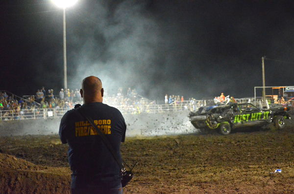 "to roll.""<p>Above: Members of the fire department were on hand and ready to act at a moment's notice.  <p>Below: Scout Redger (left) and Tharren Wagoner tip during the lawn mower derby Saturday night. Wagoner won the event, while Redger finished second. Markley said concerns about lawn mowers tipping were addressed this year. ""We made a smoother surface for the mowers when we ran them, and we wetted it down so they could slide instead of tip,"" he said. ""Even though we still had two of them that did tip, it wasn't near as bad as last year.""<p>"