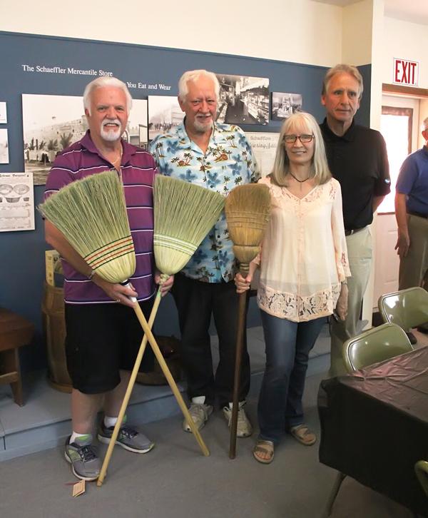 Descendants donate brooms