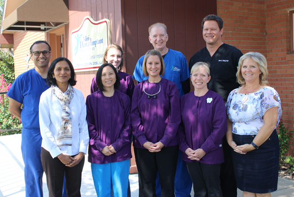 The staff at Sunflower Smiles, the recently acquired dental office from Loren Loewen, includes: front row (from left) Varsha Jhawer, dentist; Kim Nguyen, RDH-hygienist; Mikki Larson, RDH-hygienist; Gail Dyck, dental assistant; Becky Huslig, wife of Dr. Huslig. Back row: Dhaval Parikh, cardiologist at Kansas Heart Hospital and husband of Dr. Jhawer; Clara Loewen, dental assistant; Loren Loewen, dentist; and Aaron Huslig, dentist.