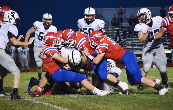 A host of Warriors team up to tackle Sterling quarterback Brady Myers, including Evann Heidebrecht (7), Kolton Brewer (33), Garrett Hoffner (46), Jacob Vondenkamp and Tyler Palic during the second quarter of Friday's game. Marion suffered its first defeat of the season by a 14-6 score.