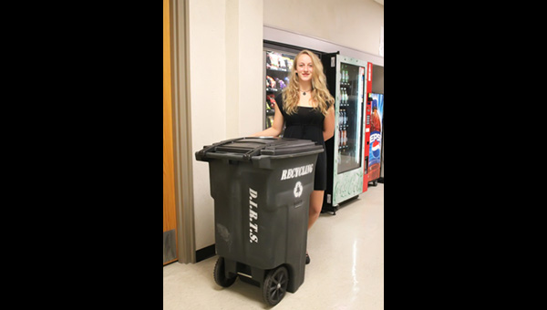 Sonja Jost has used her own funds to buy three recycling carts that are available to students in strategic places—like the vending machines.